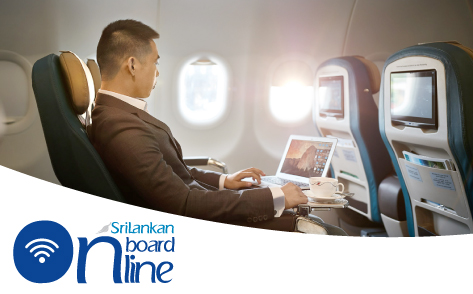 A female passenger in business attire is using a laptop connected to inflight wifi