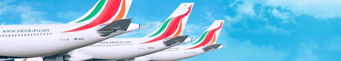 Six SriLankan Airlines flights parked upon the apron with only their tails visible with the logo